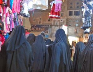 Yemeni women rushing through the souk during Ramadan....